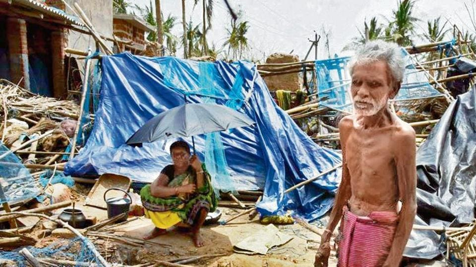 A man and a woman seen amid destruction in the aftermath of Cyclone Fani.