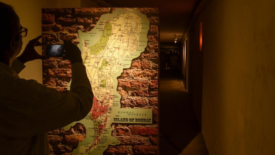 A visitor click pictures of a map inside the Bunker Museum at Raj Bhavan. According to officials, the bunker was created in the 19th century to fire cannons at approaching enemy ships and another section depicts the history of Raj Bhavan (Kunal Patil / HT Photo)