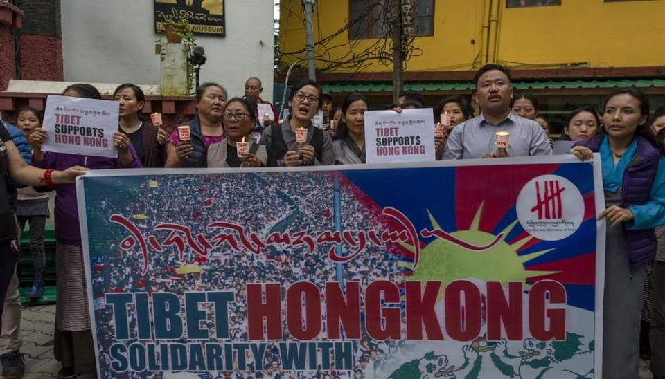 Exile Tibetans participate in a candle-lit vigil in solidarity with protestors in Hong Kong, in Dharmsala, India.