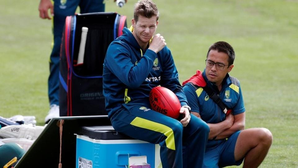 Australia's Steve Smith with team doctor Richard Saw during nets.