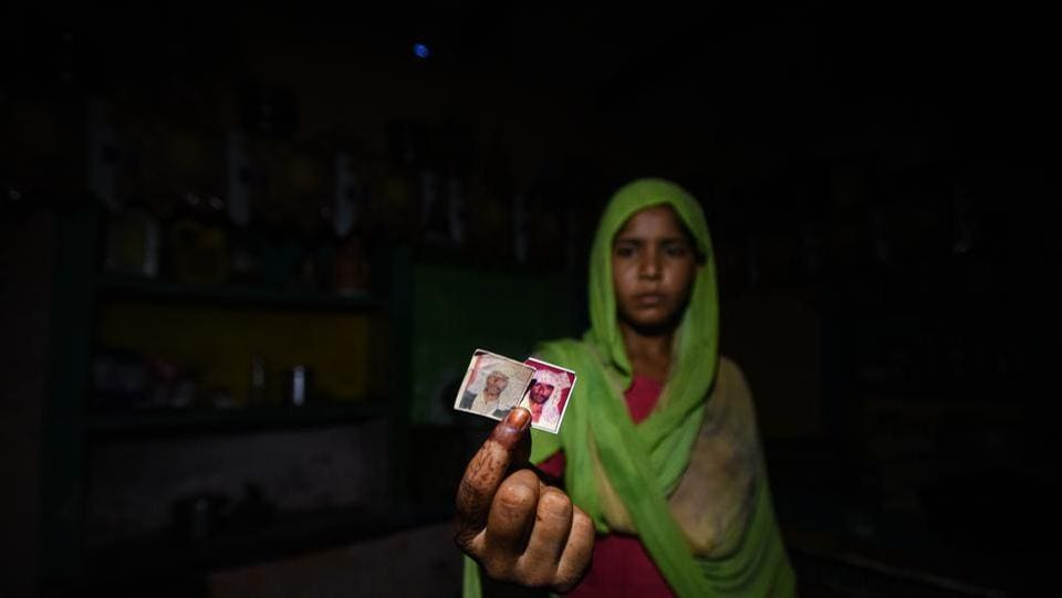 Pehlu Khan's youngest daughter holds out photos of her father, in Nuh, Haryana. In 2017, before Ramzan, Pehlu Khan, a cattle trader from Haryana's Nuh, went to a market in Rajasthan to buy buffaloes in order to expand his dairy business. Little did he know the decision would result in his death. (Amal KS / HT Photo)