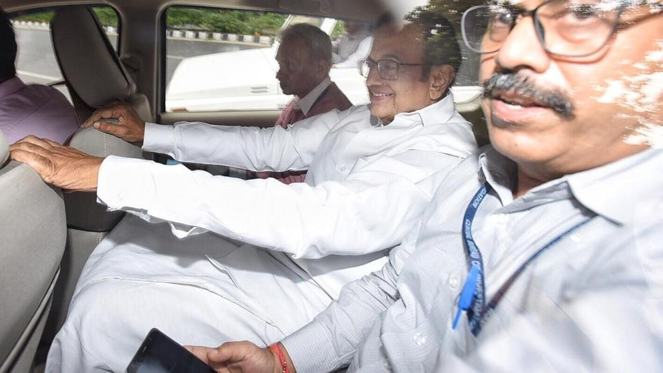 Former finance minister P Chidambaram flanked by CBI officials, on the way to the CBI court