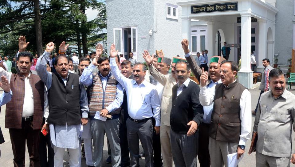 Leader opposition Mukesh Agnihotri along with Congress legislatures raising anti-government slogans outside the House in  Shimla on Thursday.