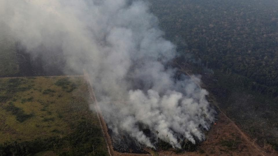 Smoke billows during a fire in an area of the Amazon rainforest near Porto Velho, Rondonia State, Brazil. A chunk of the Amazon rainforest has been consumed by fires for weeks now. The number of forest fires in Brazil surged in the first eight months of 2019, as President Jair Bolsonaro faces growing criticism over rampant destruction of the Amazon. (Ueslei Marcelino / REUTERS)