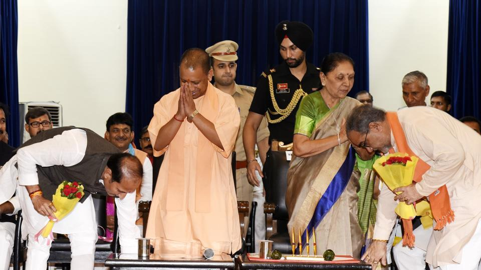 Ministers taking blessings from UP Chief Minister Yogi Aditiyanath and UP Governor Anandiben Patel during the swearing-in ceremony at Raj Bhawan,Lucknow,  on Wednesday, 21, 2019.