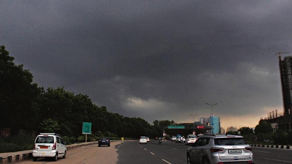 Black clouds hover over the city, in Gurugram