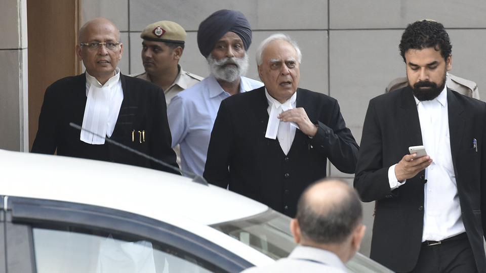 Kapil Sibal along with Abhishek Manu Singhvi and team members
