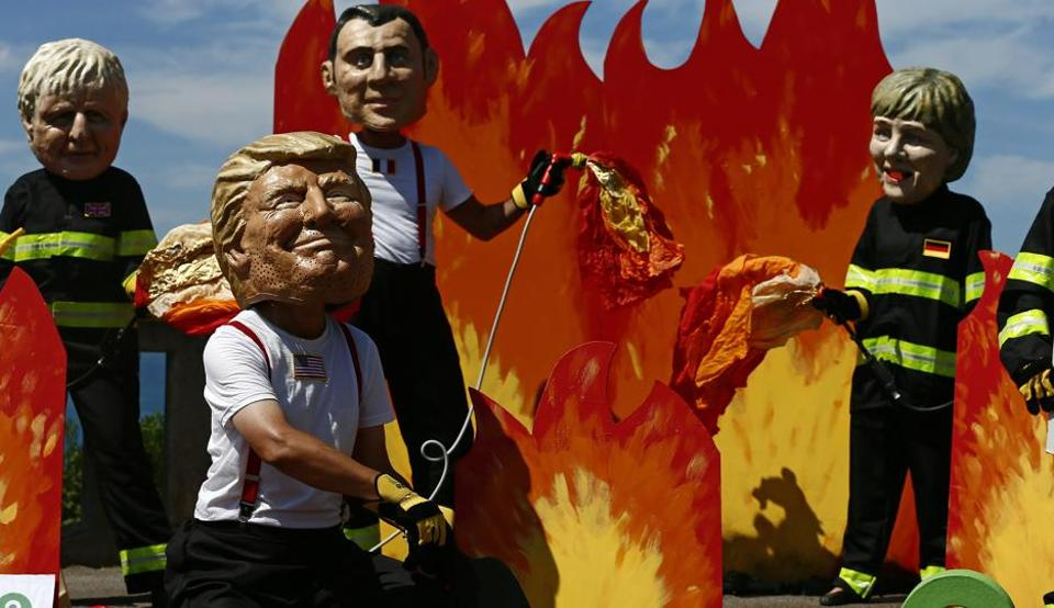 A man wearing a mask President Donald Trump, front left, is joined by other 'world leaders' during a protest ahead of the G-7 summit in Biarritz, France Friday, Aug. 23, 2019.
