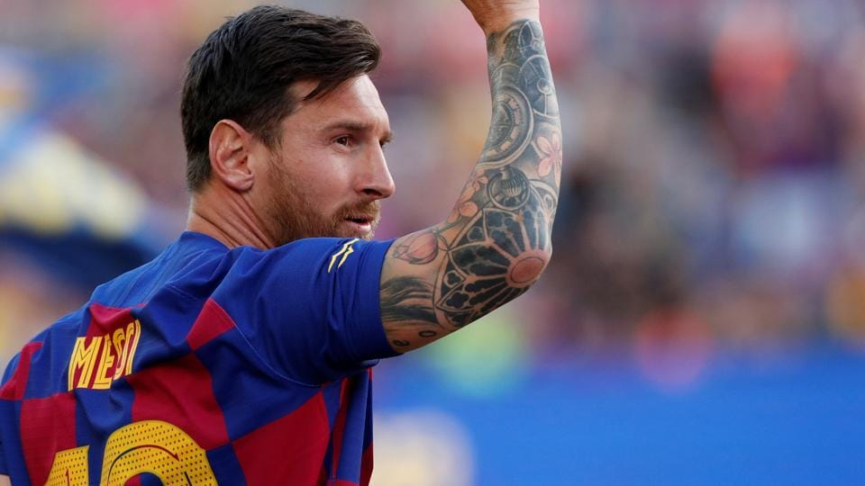 Barcelona's Lionel Messi waves to fans.