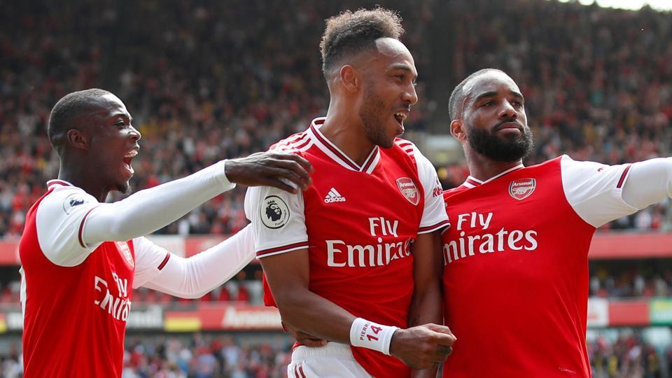 Arsenal's Pierre-Emerick Aubameyang celebrates with teammates after scoring a goal.