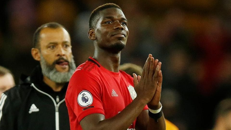 Manchester United's Paul Pogba gestures to fans