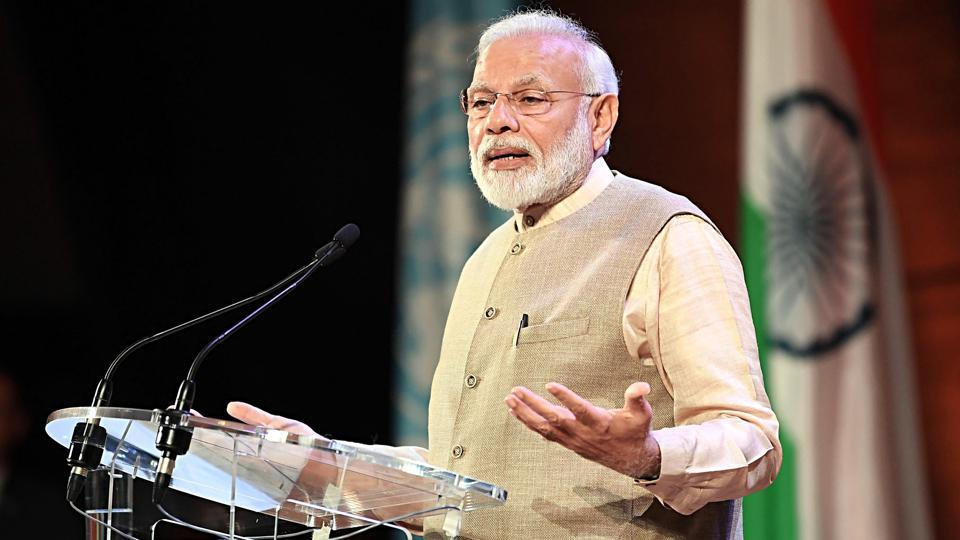 Prime Minister Narendra Modi addressing the Indian community, at UNESCO Headquarters in Paris on Friday.