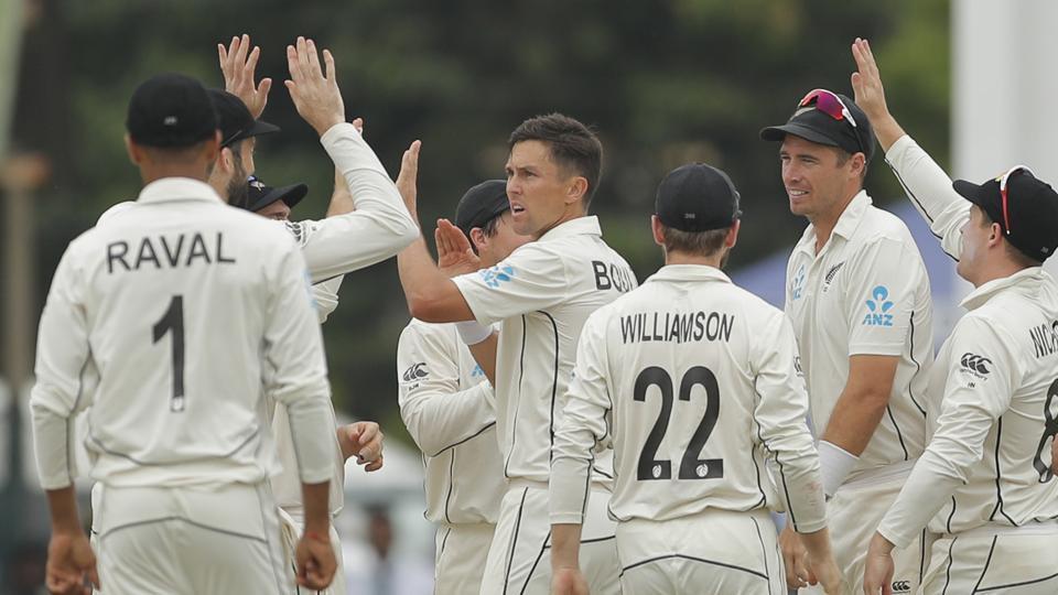 New Zealand's Trent Boult, center, celebrates the dismissal of Sri Lanka's Kusal Perera.