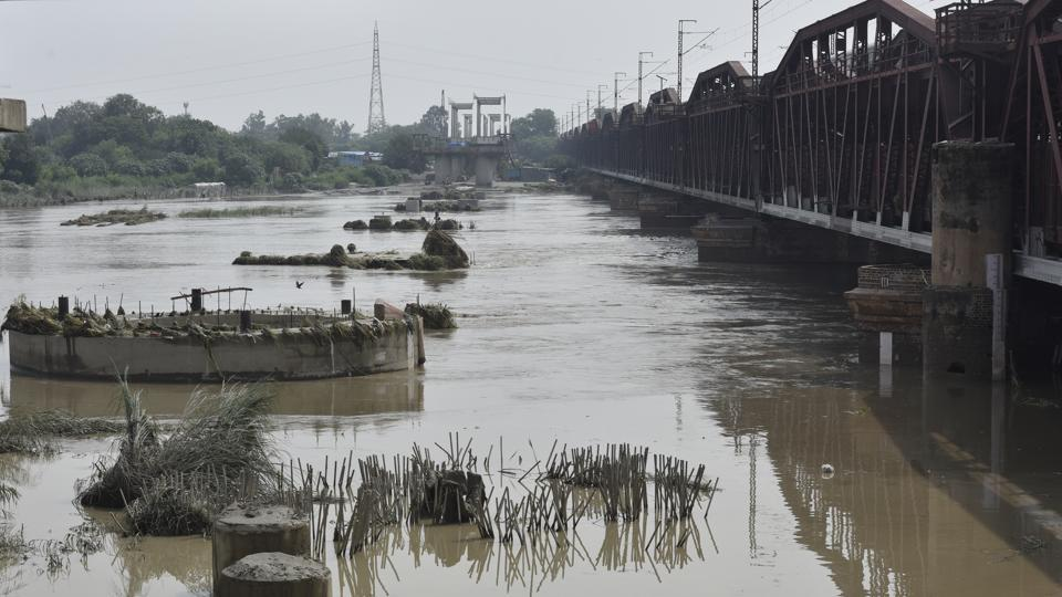 A view of Yamuna near the Old Iron Bridge after water levels in the Yamuna River began dropping in New Delhi.