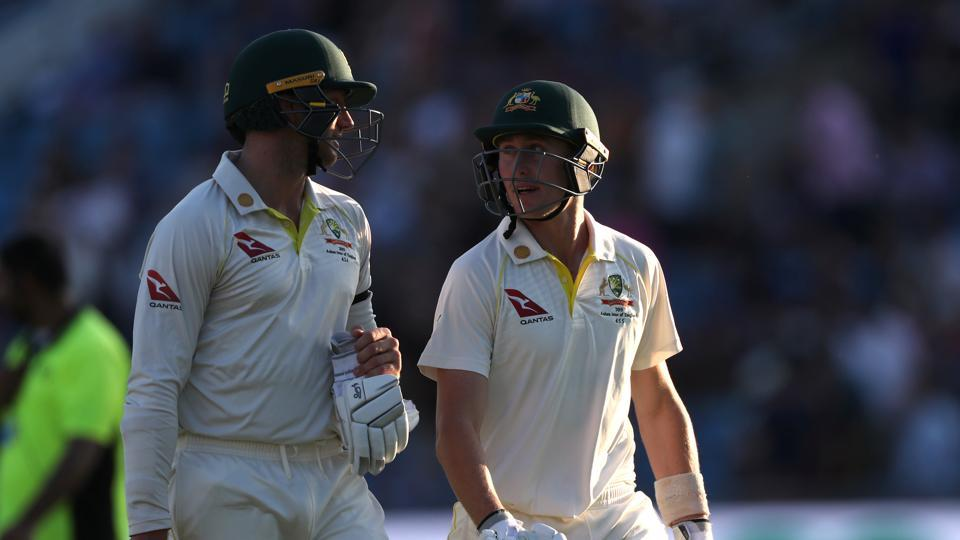 Australia's Marnus Labuschagne and James Pattinson leave the pitch at the end of play on day two.