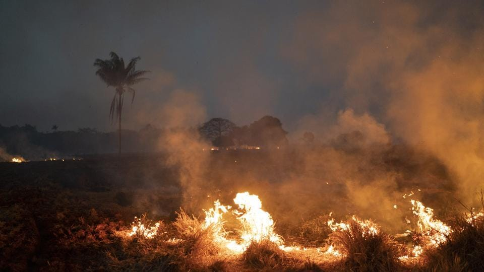 A fire burns a field on a farm in the Nova Santa Helena municipality, in the state of Mato Grosso, Brazil.