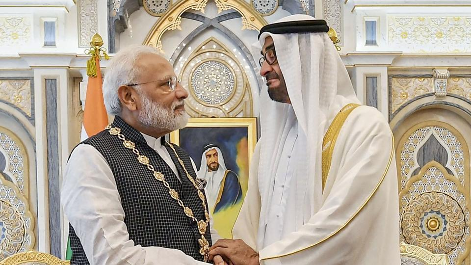 Prime Minister Narendra Modi shakes hands with Crown Prince of the Emirate of Abu Dhabi and Deputy Supreme Commander of the United Arab Emirates Armed Forces Sheikh Mohammed bin Zayed Al Nahyan after being conferred ' Order of Zayed'-- UAE's highest civil decoration, in Abu Dhabi, Saturday, Aug 24, 2019.