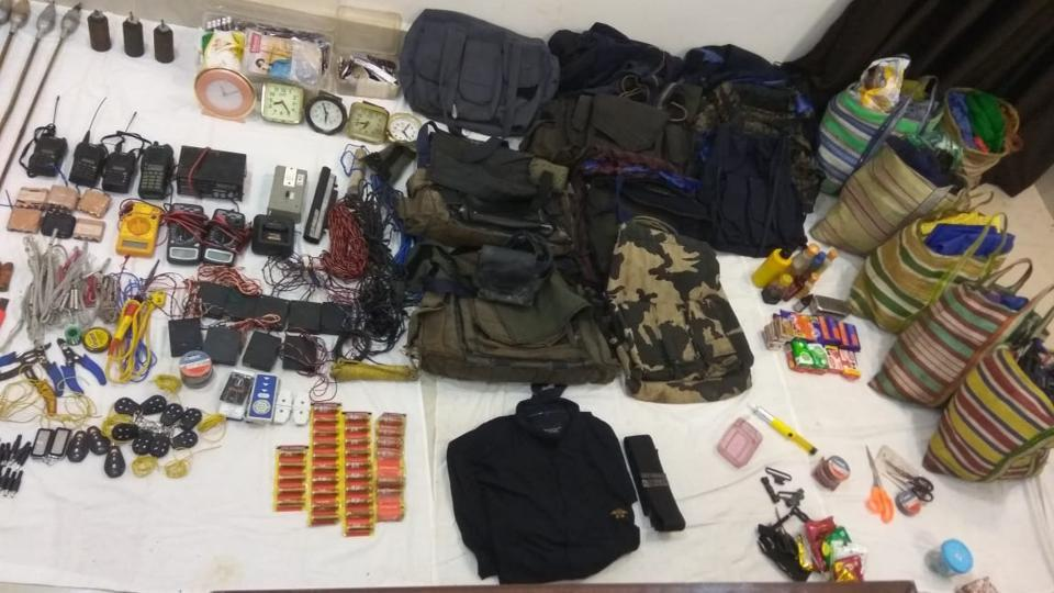 The police team seized explosives , ammunition and documents from the site of the encounter.