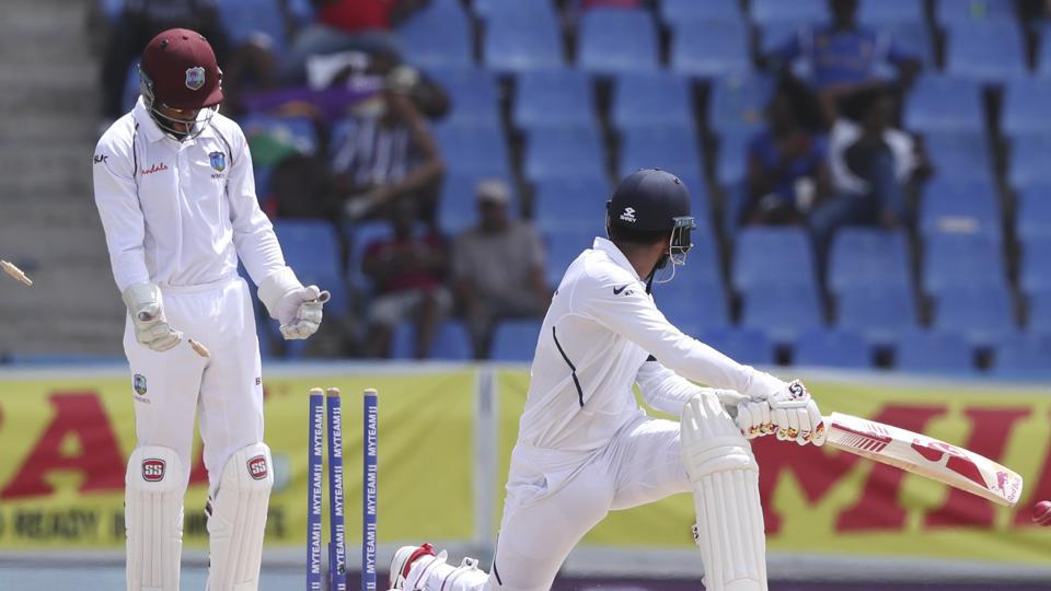 India's KL Rahul is bowled by West Indies' Roston Chase.