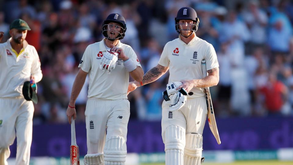England's Joe Root and Ben Stokes leave the pitch at stumps.