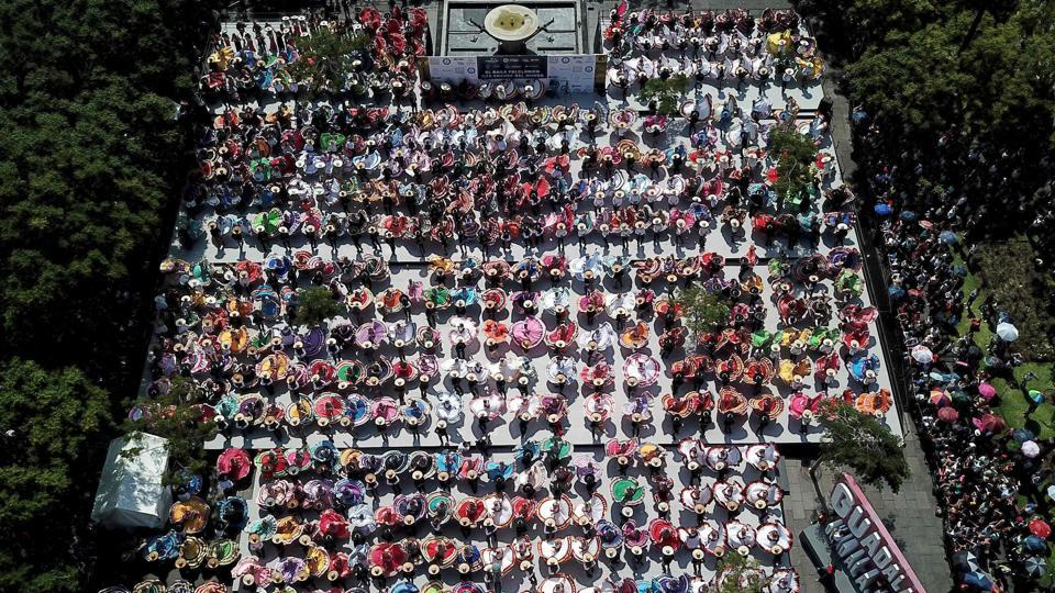 An aerial view of couples dancing to traditional Mariachi music. The previous record, also set in Guadalajara in 2011 has comprised 457 participants. (Ulises Ruiz / AFP)