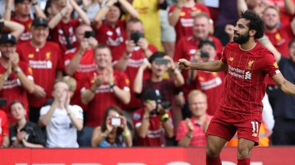 Liverpool's Mohamed Salah celebrates scoring their third goal.