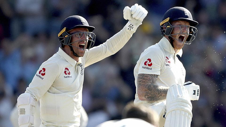 England's Jack Leach and Ben Stokes, right, celebrate England's victory.