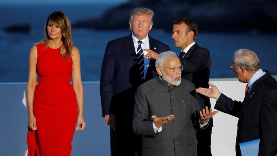 French President Emmanuel Macron, US President Donald Trump and First Lady Melania Trump, Indian Prime Minister Narendra Modi and Development (OECD) Secretary-General Angel Gurria after posing for a family photo with invited guests during the G7 summit in Biarritz, France, August 25, 2019.