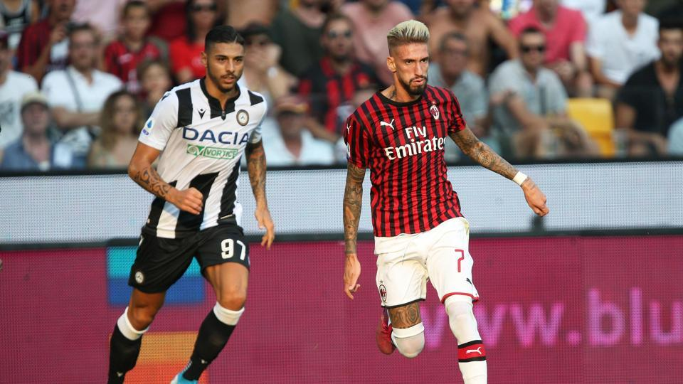 Giuseppe Pezzella, left, andSamuel Castillejo vie for the ball during the Italian Serie A soccer match between Udinese and AC Milan.