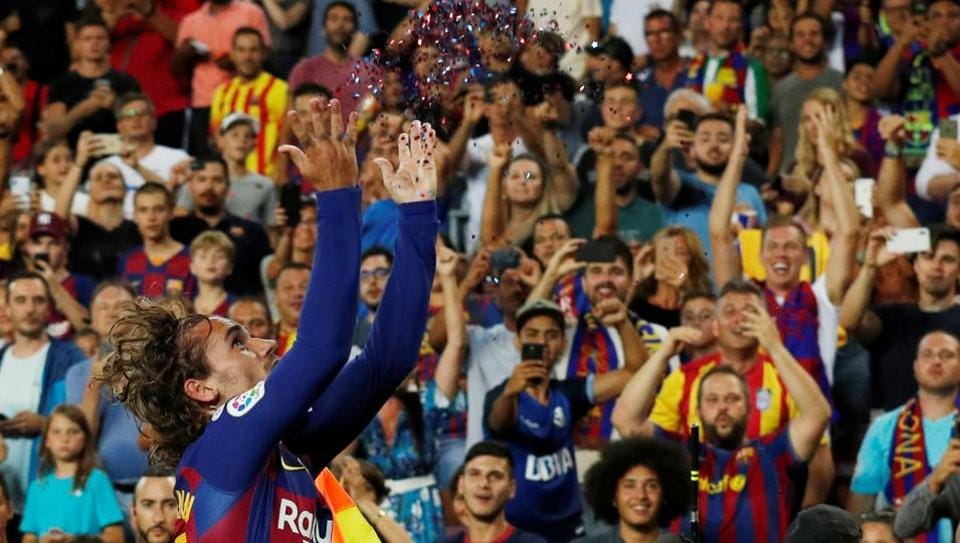 Barcelona's Antoine Griezmann celebrates scoring their second goal.