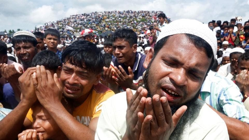 Rohingya refugees take part in a prayer as they gather to mark the second anniversary of the exodus at the Kutupalong camp in Cox's Bazar, Bangladesh.