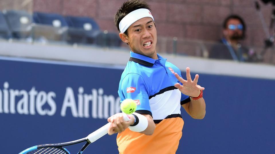 Kei Nishikori of Japan hits to Marco Trungelliti (not pictured) of Argentina.