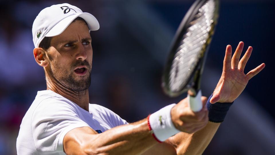 Novak Djokovic, of Serbia, returns the ball as he practices for the U.S. Open tennis tournament.