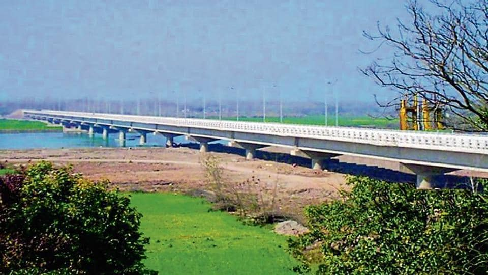 The bridge was constructed at a cost of ₹110 crore; and (right) the contractor has fastened bolts into the blocks of the retaining walls to contain the damage.