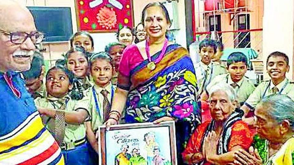 Students and school official of Narayana e-Techno School, Kalyan, at an old-age home