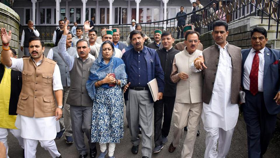 Leader opposition Mukesh Agnihotri (third from left) along with Congress legislatures staging a walk out during monsoon session in Shimla on Tuesday.