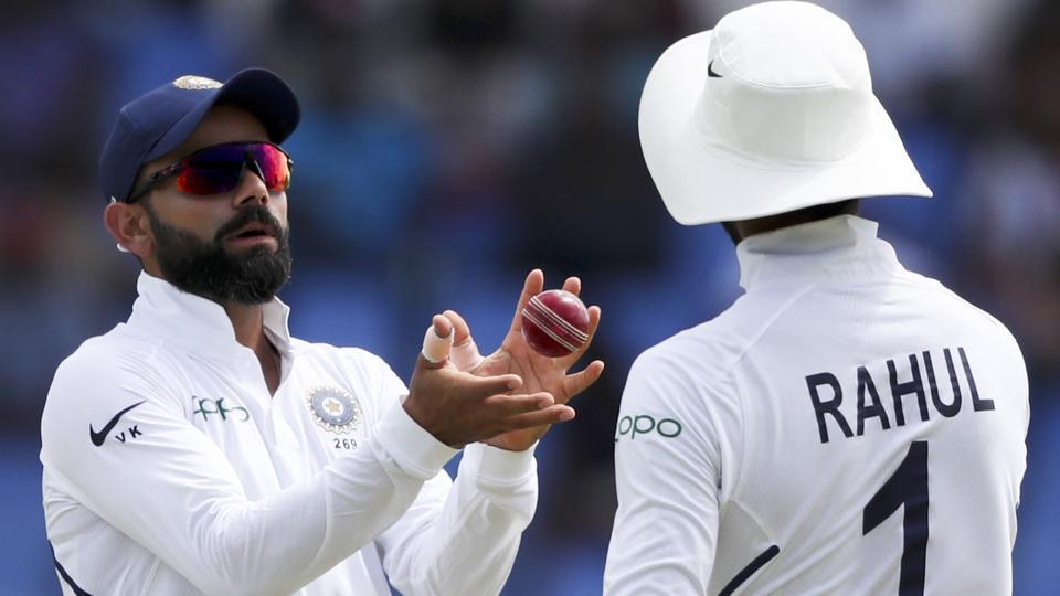 India's captain Virat Kohli gets the ball from India's KL Rahul.