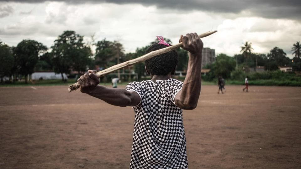 A Ngbaba player stretches out before a game in Bangui. Ngbaba is a traditional Central African sport which fell into disuse in the 2000s due to the security situation in the country, and is now being revived by young enthusiasts thanks to the lull in the conflict. The sport, is unique to the Central African Republic -- and, almost like the embattled country itself, has been hauled back from near-death. (Florent Vergnes / AFP)