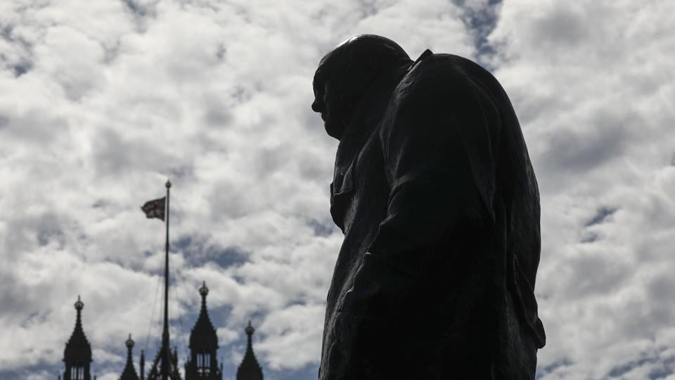 A statue of Winston Churchill, former British prime minister, stands near the Houses of Parliament in London, U.K., on Wednesday, Aug. 28, 2019.