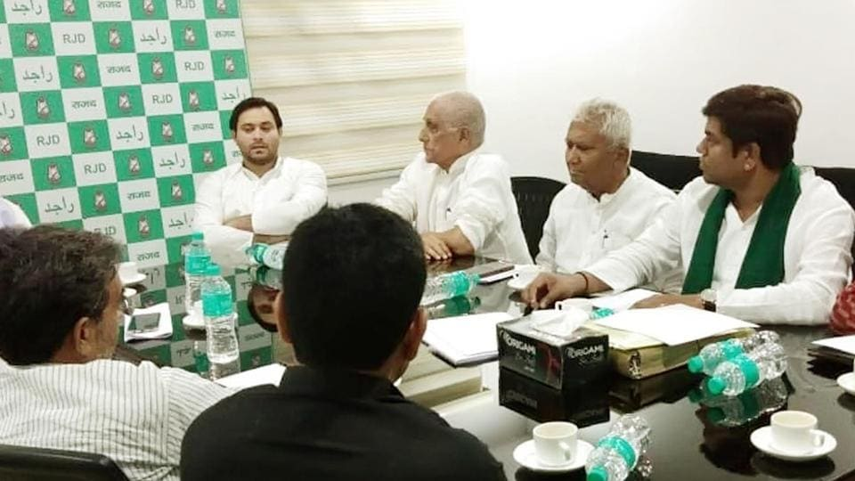 RJD leader Tejashwi Yadav with other leaders of Grand Alliance  at a meeting on Monday, August 26, 2019.