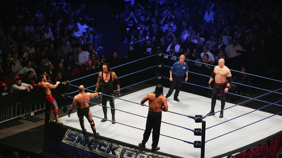 WWE star Underataker with other wrestlers in action during 'Smackdown'.