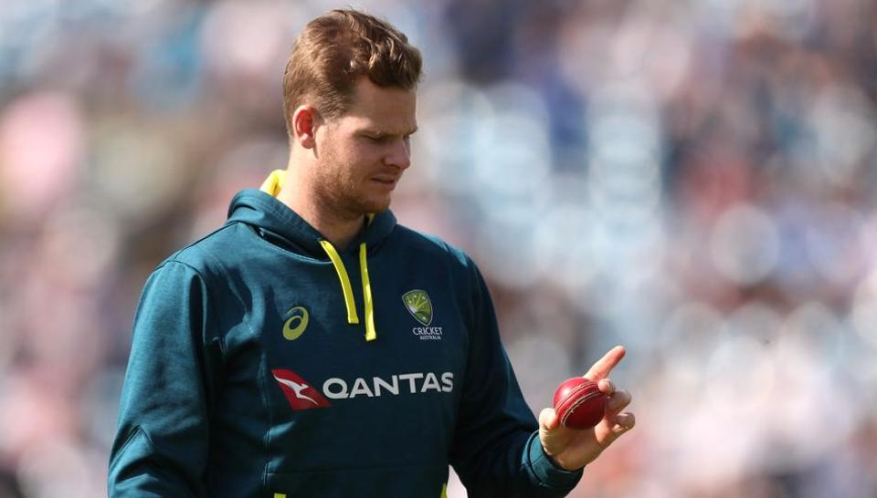 Australia's Steve Smith inspects a ball before the start of play.
