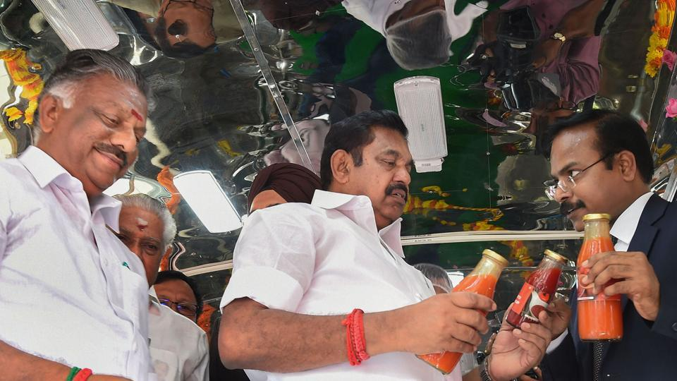Tamil Nadu Chief Minister Edappadi K Palaniswami with his deputy O Panneerselvam looks at a bottle of tomato juice in a vehicle that can makes juices or soups from tomatoes purchased directly from farmers, as a part of government's initiative, at Fort St. George in Chennai. Other party colleagues believe that the Chief Minister has proved that he is no push over, but a leader capable of steering the AIADMK ship.