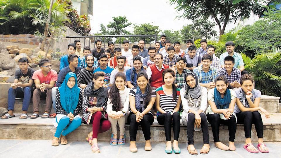 Students from Kashmir studying at Sarhad, Pune, with founder-president Sanjay Nahar (red sweater).