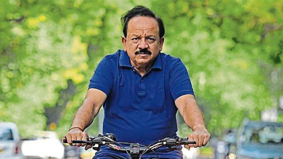 Union minister Harsh Vardhan rides his bicycle at Tees January Marg in New Delhi on August 28.