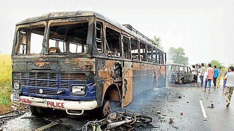 A police vehicle torched by anti-sacrilege protesters in Faridkot district's Behbal Kalan village in October, 2015.