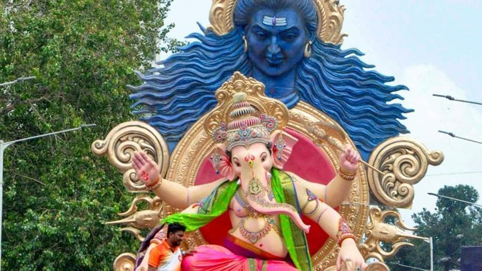 Devotees carry an idol of Ganesha to the pandals ahead of the upcoming Ganesh Chaturthi in Mumbai.