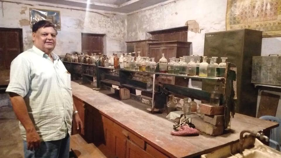 Principal of a government-aided intermediate school showing the poor state of the science lab of his institution.