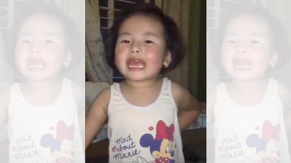 The video shows a little girl singing the song with total gusto.