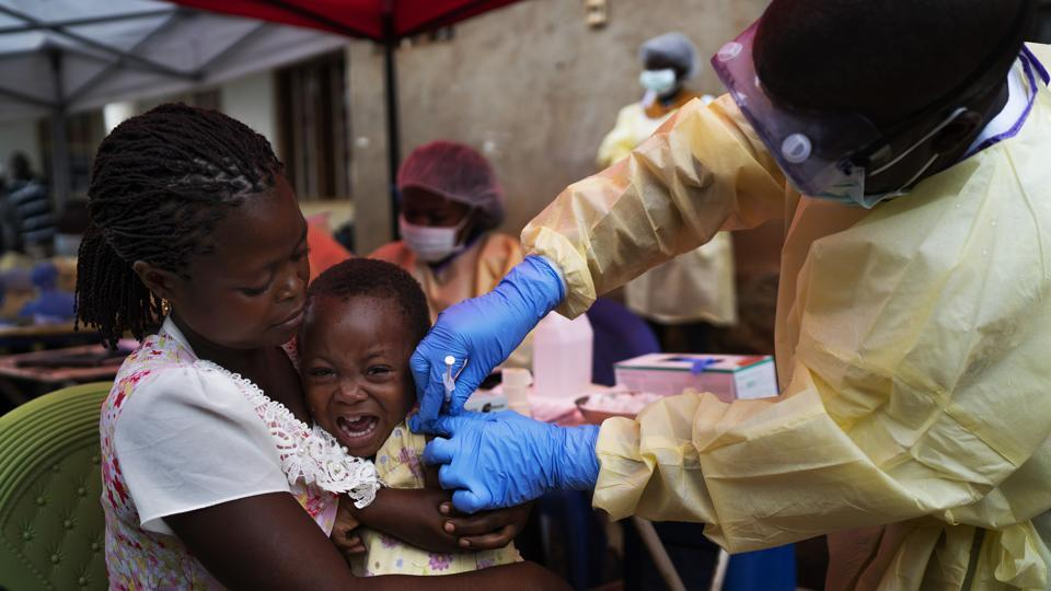 A child being vaccinated against Ebola in Beni, Congo.